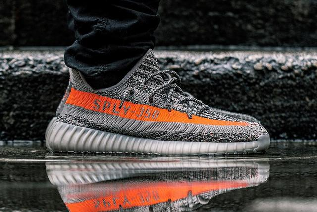 ad5ab649eaaf The Steeple Gray Beluga Solar Red adidas Yeezy Boost 350 V2 is the first of the  2nd version colorways that release in 2016.